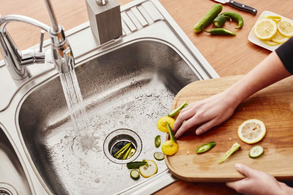Plumb a Kitchen Sink With Disposal and Dishwasher 2
